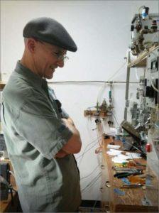 Jeff Kaskey working on machinery